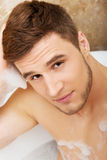 Handsome man taking a bath. Royalty Free Stock Photo