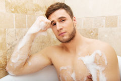 Handsome man taking a bath. Royalty Free Stock Image