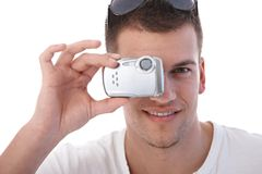 Handsome man taking photo at summertime Royalty Free Stock Photography