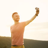 Handsome man taking pictures of him self with action camera Royalty Free Stock Photo