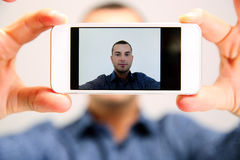 Handsome man taking selfie Royalty Free Stock Image