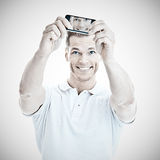 Handsome man taking a selfie Royalty Free Stock Photos