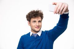 Handsome man taking selfie photo on smartphone Stock Photography