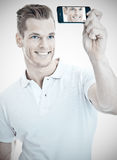 Handsome man taking a selfie Royalty Free Stock Images