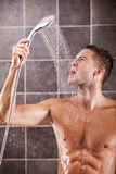 Handsome man taking a shower Stock Image