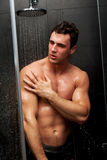 Handsome man taking the shower. Stock Photography