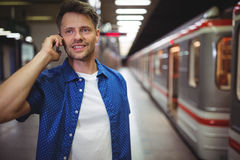 Handsome man talking on mobile phone Royalty Free Stock Photo