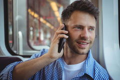 Handsome man talking on mobile phone Royalty Free Stock Photography
