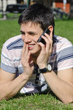 Handsome man talking on phone Stock Images