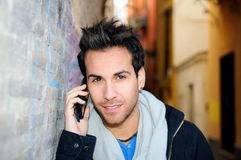 Handsome man talking on phone Stock Photos