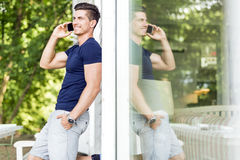 Handsome man talking on the phone outdoors Royalty Free Stock Photo