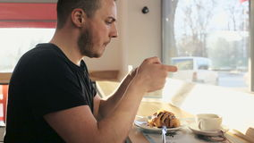 Handsome man talking photo of meal with cellphone sitting in cafe stock footage