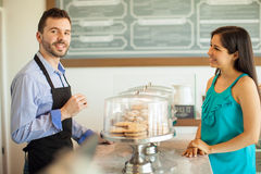 Handsome man talking to a customer Royalty Free Stock Photography