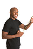 Handsome man with tape measure. Handsome African-American repairman measures with tape measure royalty free stock photo