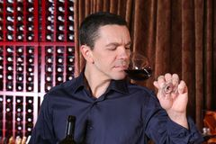 Handsome man tasting wine. Handsome man tasting red wine Stock Photography