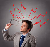 Handsome man thinking with arrows overhea. Handsome man standing and thinking with arrows overhead Stock Photography
