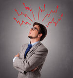 Handsome man thinking with arrows overhea Stock Photography