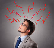 Handsome man thinking with arrows overhea. Handsome man standing and thinking with arrows overhead Royalty Free Stock Photos