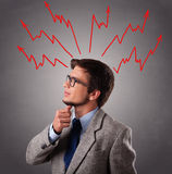 Handsome man thinking with arrows overhea Stock Images