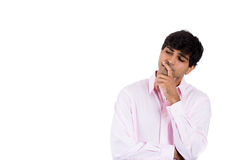 handsome man thinking deeply with hand on chin looking to side Royalty Free Stock Images