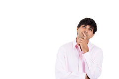 Handsome man thinking deeply with hand on chin looking upwards Stock Images