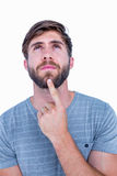 Handsome man thinking with finger on chin Stock Photography