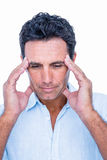 Handsome man thinking with hand on forehead Stock Images