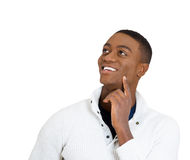 Handsome man thinking looking up stock photo