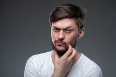 Handsome man is thinking about serious things royalty free stock photography