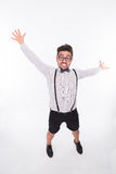 Handsome man threatening at somebody. Emotional handsome man threatening at somebody. Hipster man in glasses raising his hands in photo studio isolated on white Stock Image