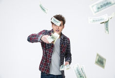 Handsome man throwing Money Into Air Royalty Free Stock Images