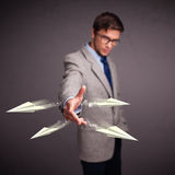 Handsome man throwing origami airplanes Stock Photography