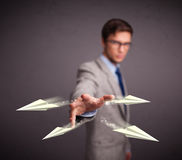 Handsome man throwing origami airplanes Stock Photo