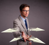 Handsome man throwing origami airplanes Royalty Free Stock Images