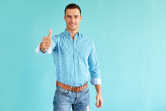 Handsome man with thumb up Stock Images