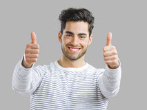 Handsome man with thumbs up Stock Photo