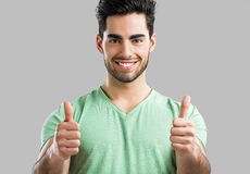 Handsome man with thumbs up Royalty Free Stock Images
