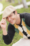 Handsome man tipping his hat Royalty Free Stock Photography