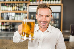 Handsome man toasting Royalty Free Stock Images