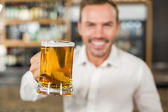 Handsome man toasting Stock Image