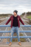 Handsome man at the top of a bridge over a highway Stock Photography