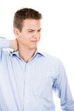 Handsome man touching back of neck in pain Royalty Free Stock Images