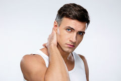 Handsome man touching his neck Royalty Free Stock Images