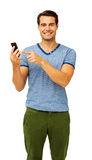 Handsome Man Touching Smart Phone Royalty Free Stock Photo