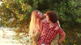 Handsome man touching woman's face by the river at sunset stock footage