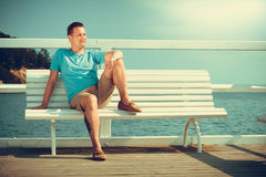 Handsome man tourist on pier. Fashion summer. Royalty Free Stock Image