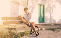 Handsome man tourist sitting on bench Royalty Free Stock Photo