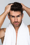 Handsome man with towel stock image