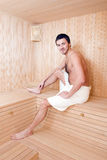 Handsome man in a towel relaxing in sauna Royalty Free Stock Image