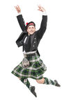 Handsome man in traditional Scottish costume jumping Royalty Free Stock Photo